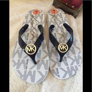 MK Flip Flops Sz 7